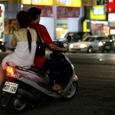 woman in nightgown on a scooter
