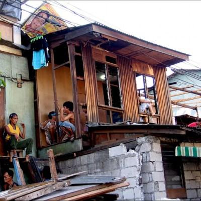 wooden house atop concrete