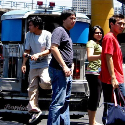 commuters stepping out of a jeepney