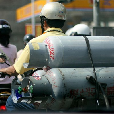 transporting gas canisters on a scooter