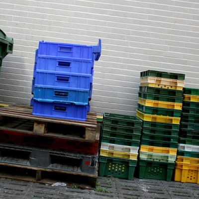 plastic crates against a wall