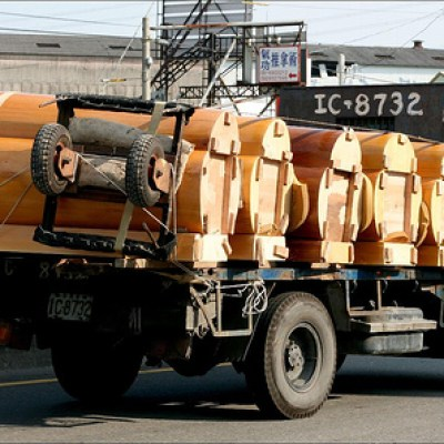 truck transporting coffins
