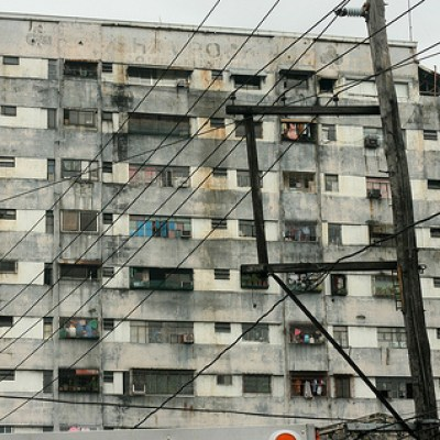 gray building with electric wires