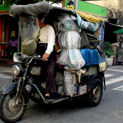guy with lots of stuff on a motorcycle