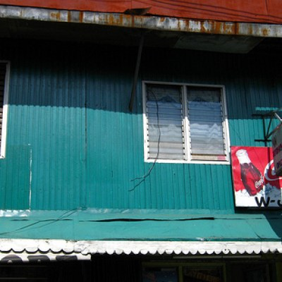 green house with Coke sign