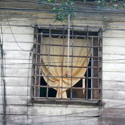 window with a yellow curtain