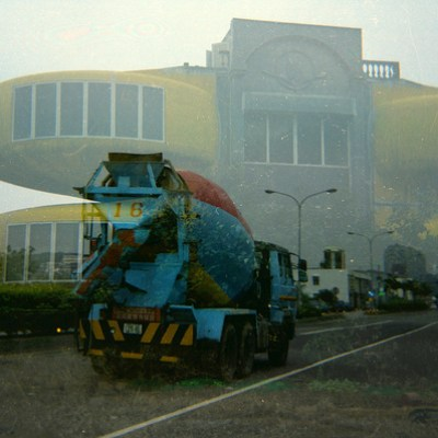 cement mixer driving into UFO house