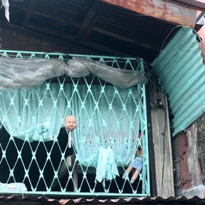 doll's head on a window