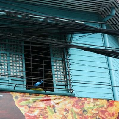 blue green window on an old Manila house
