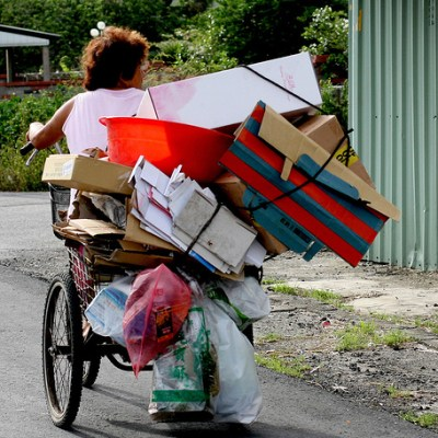 woman carrying lots of boxes on her bike