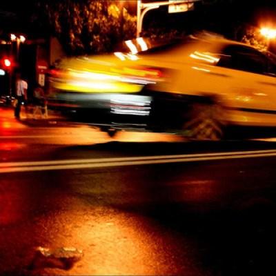 taxi hurtling through a rainy night