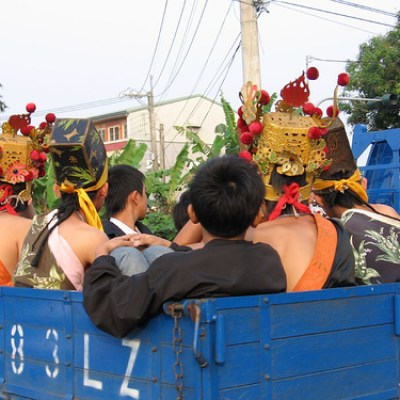 guys in traditional costume on the way to some temple celebration