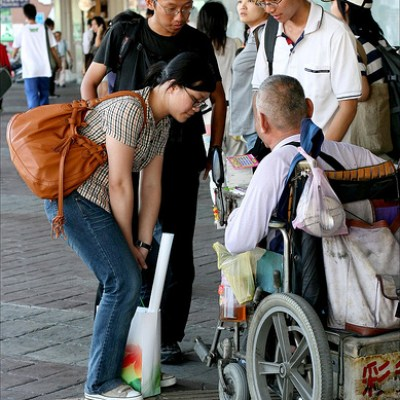 people talking with wheelchair man