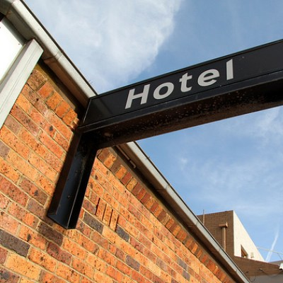 hotel sign on a brick wall