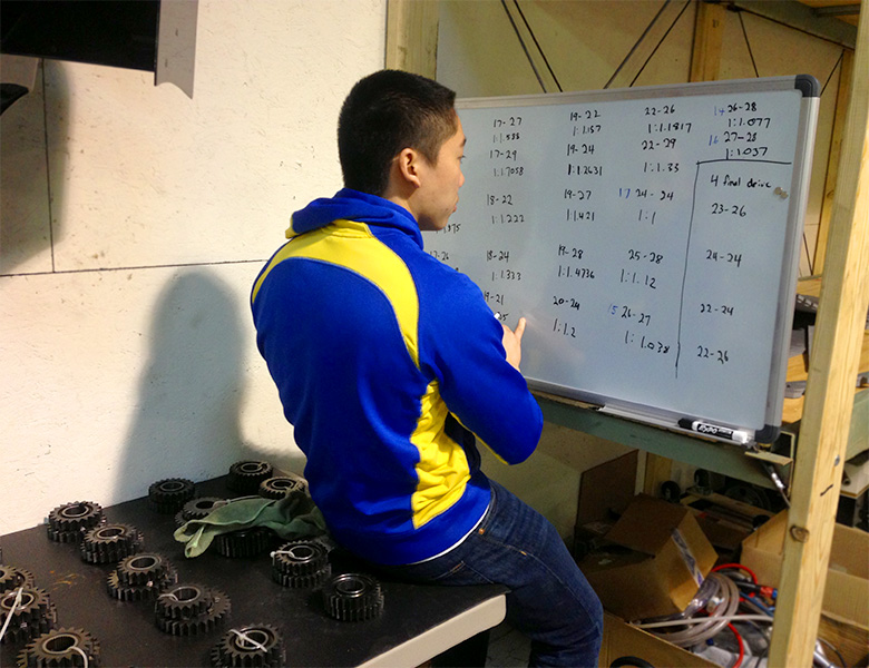 Lawrence Lei calculating gear ratios for the gear box