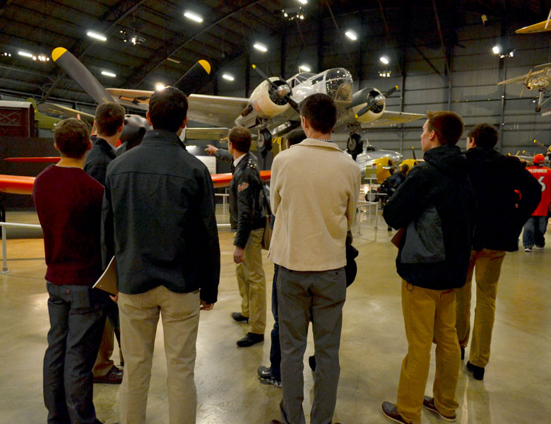 Casey takes the reins and teaches the students about some of the planes in the museum.