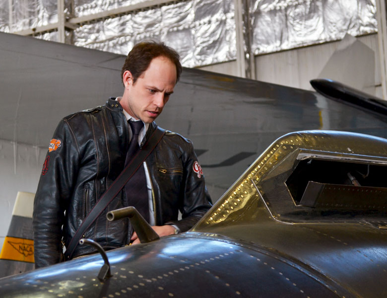 Casey looks into the window of an X-15 experimental speed plane.