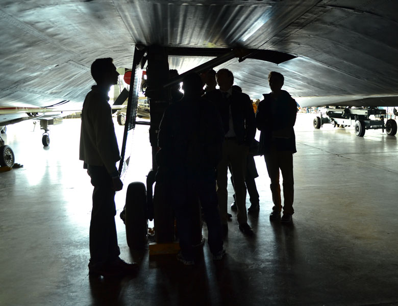 Nice silhouettes of the Genius Garage team members inside the experimental section of the Wright Patterson Air Force Base.