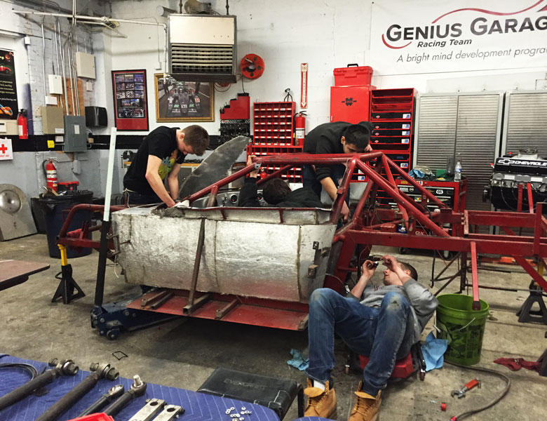 Clint, Chris, Federico, and Max are all very busy working on the chassis.