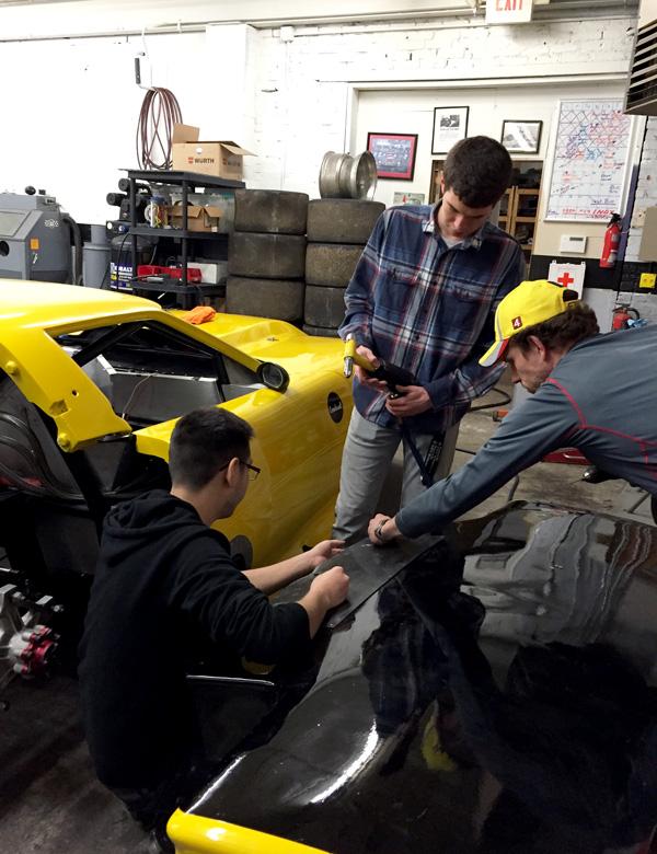 Federico Aponte, Chris Scherzer, and Casey Putsch work on riveting; teamwork, teamwork, teamwork!
