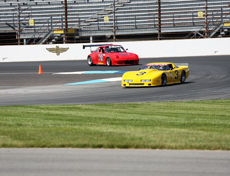 Passing the red Porsche, entering and exiting Turn 1 with swiftness and speed is Casey's game.