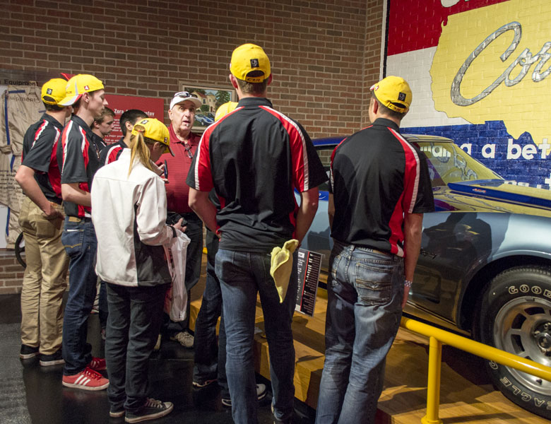 Michael Murray tells the students about the Corvette he pinstriped which is currently on display in the museum.