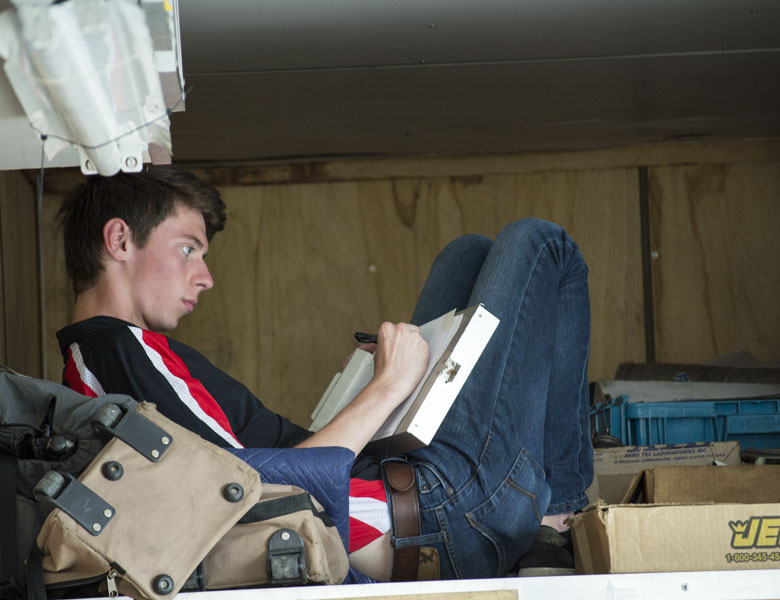 "Dan has found his new ""thinking space"" in the trailer to do his set-up sheets."