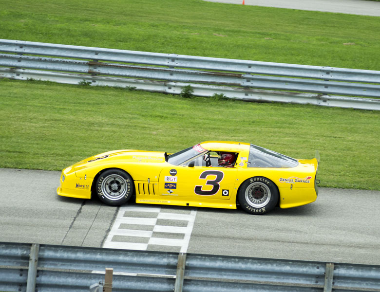 Thumbs up from the number 3 Corvette as it flies down the front straight!