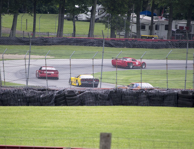 Casey is currently in third behind a red Oldsmobile and Corvette, but he is catching them quickly!