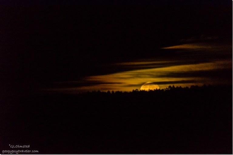 Hunter moon rise with clouds North Rim Grand Canyon National Park Arizona