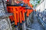 Mini Tojii gates left as offerings at the Fushimi Inari shrine