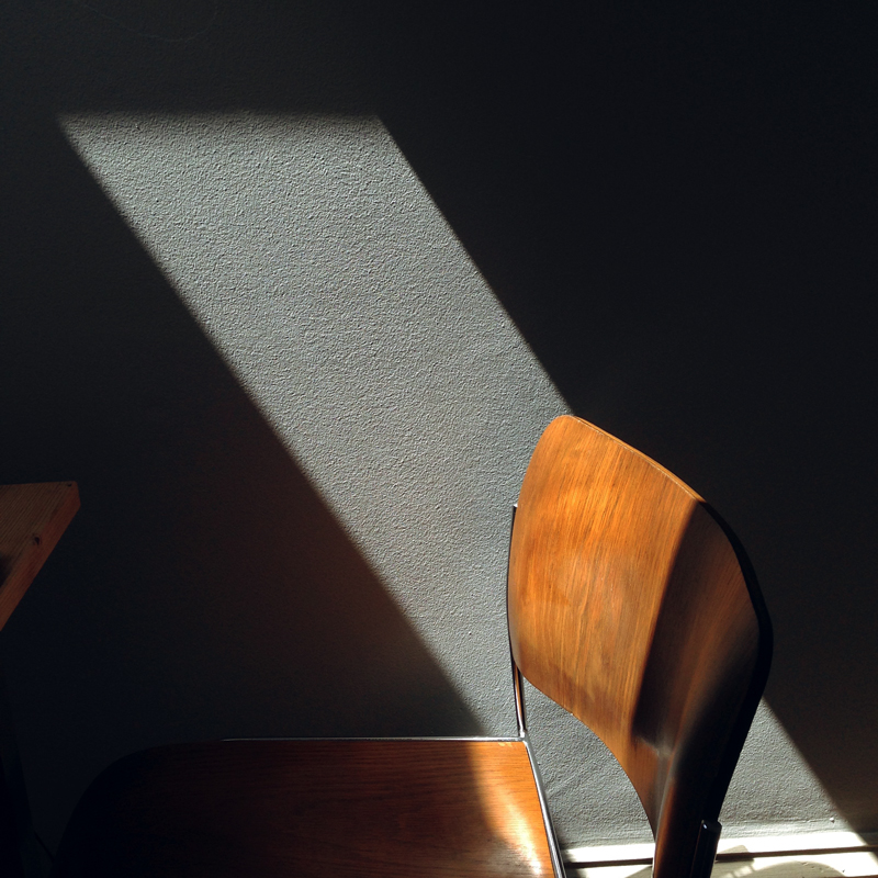 dramatic lit chair