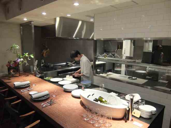 Chef, open kitchen and counter at Michelin starred restaurant Hiroto in Hiroshima, Japan