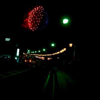 Lanterns along the street and fireworks in the sky... aaah Japan