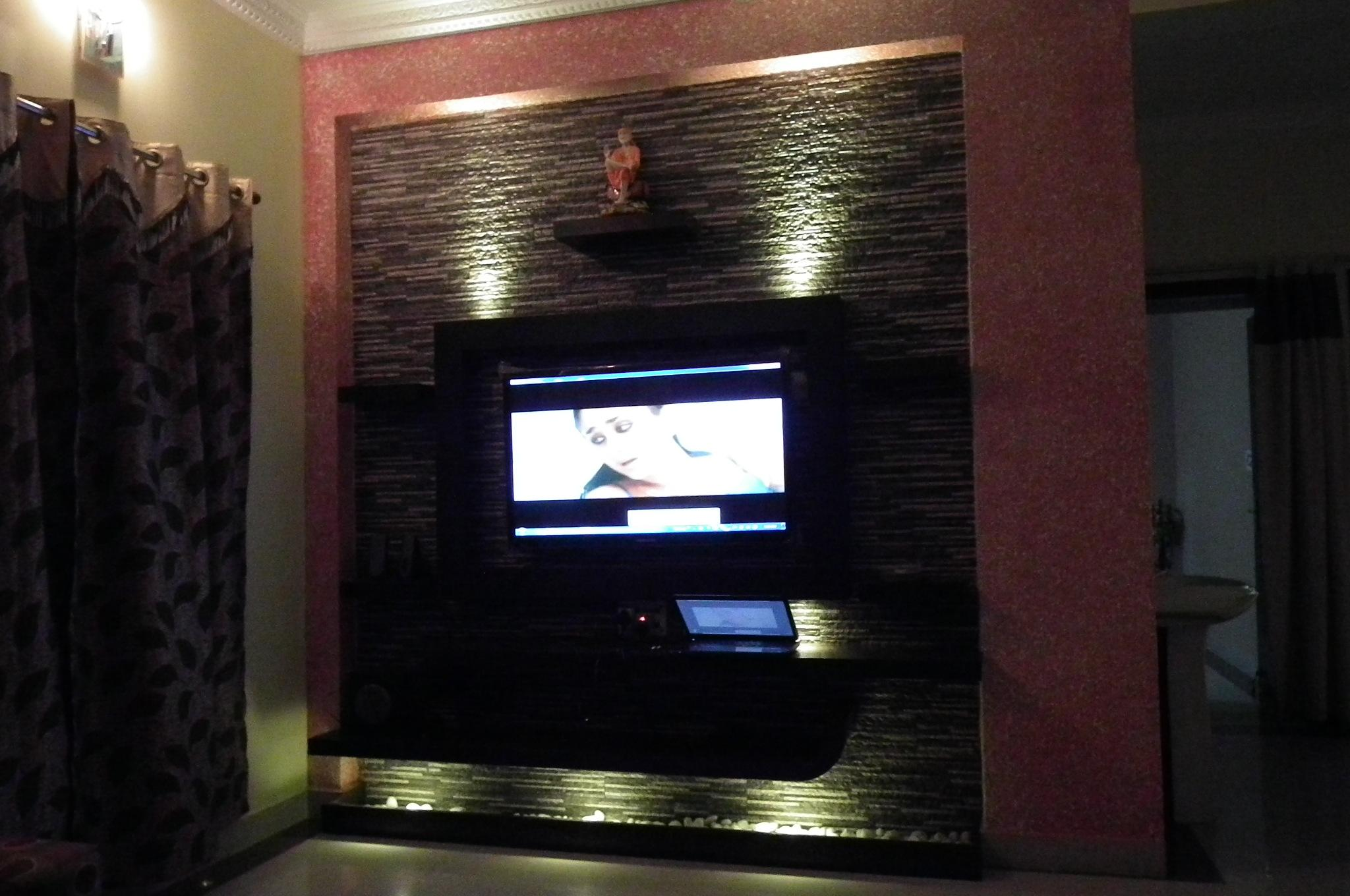 How High To Mount Tv On Wall In Bedroom Lcd Tv Wall With Dark Color Stone Cladding Gharexpert