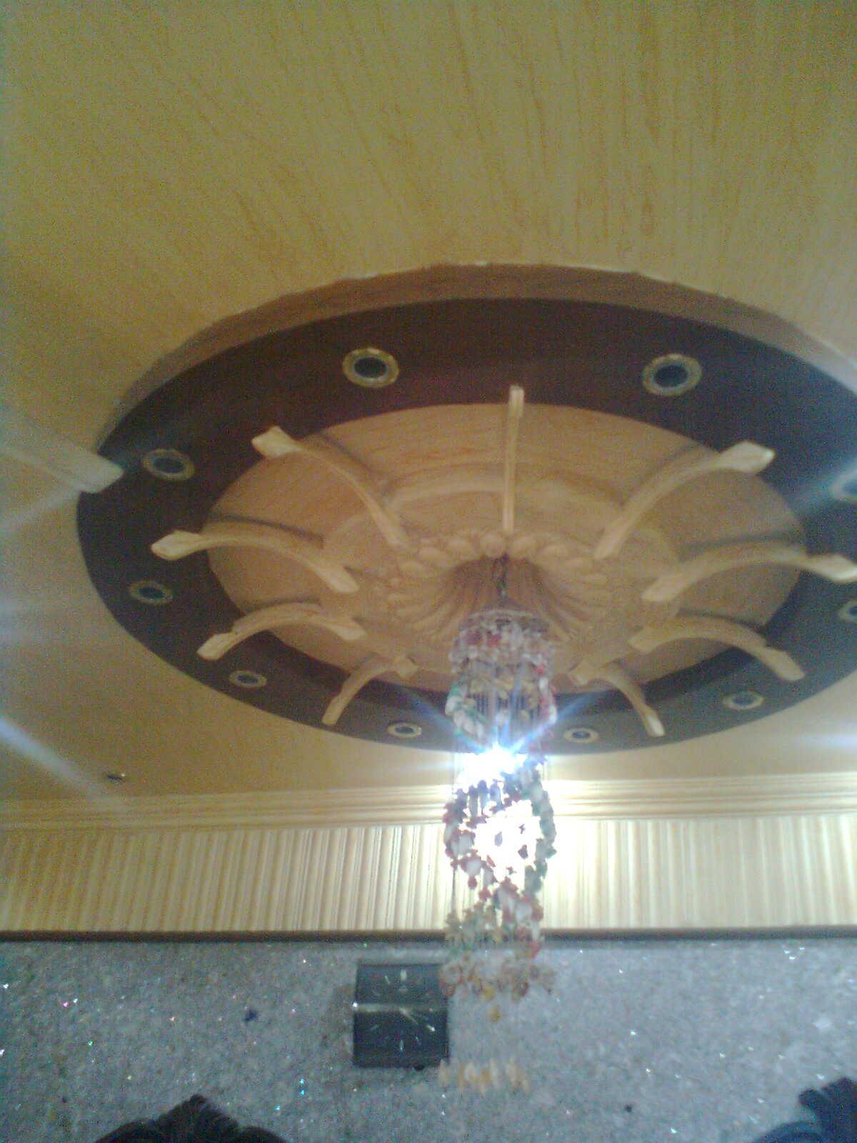 Ceiling Design Online False Ceiling Design With Round Around The Chandelier Lights By