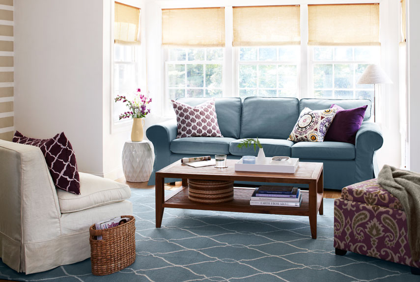 Traditional-style furniture gets an dash of regal style with rich purple accents and an oversized rug to anchor the conversation space.<br /><br /><br data-recalc-dims=