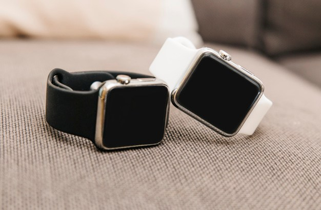 close-up-of-two-black-and-white-smartwatch_23-2147797004