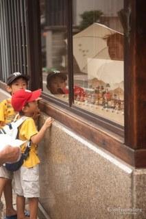 boys children mini floats byobu matsuri traditional architecture shopfront gion festival kyoto japan