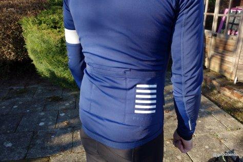 Rear Rapha Pro Team Jacket details including pockets and reflective details