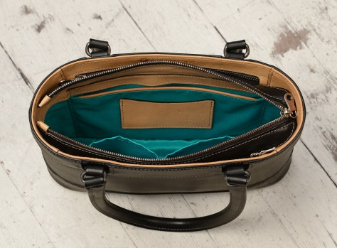 Hand-burnished-black-Hand-Bag-with-hand-grained-natural-trim-and-turquoise-grosgrain-lining;-12-x-8-x-3'-topdown3