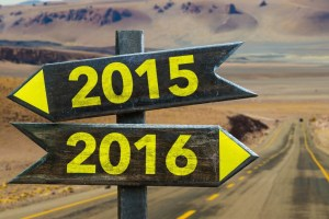 2015 - 2016 signpost in a desert road background