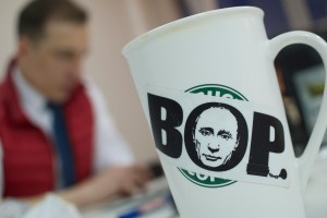 "A portrait of Russian President Vladimir Putin printed on a sticker with a word 'Thief"" put on a cup in anti-corruption activist Alexei Navalny's office in Moscow, Russia, on Monday, Jan. 27, 2014. Photo Credit: AP Photo/Ivan Sekretarev"