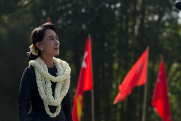 Myanmar opposition leader Aung San Suu Kyi pauses during a rally in her constituency of Kawhmu township in Yangon, Myanmar, Saturday, Dec. 14, 2013. Photo Credit: AP Photo/Gemunu Amarasinghe