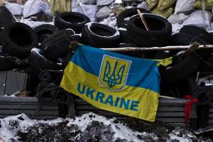 Ukrainian flag on the barricade, in Kiev, on January 31, 2014. Photo Credit: Sergii Kharchenko/NurPhoto/Sipa USA