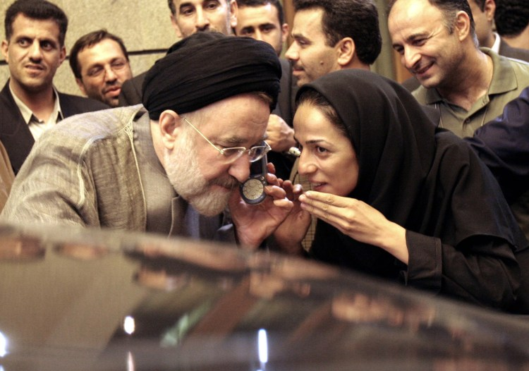 Former Iranian President Mohammad Khatami, with Masih Alinejad, right, after a meeting with Iranian journalists in Tehran on  July 13, 2005. (AP Photo/Hasan Sarbakhshian)