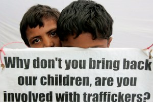 Indian children take part in a protest against child trafficking in New Delhi, India