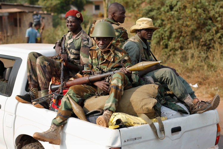 Seleka Muslim militias drive through Bangui, Central African Republic Jan. 27, 2014. (AP Photo/Jerome Delay)