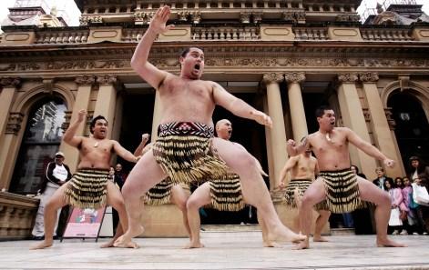 Members of the New Zealand Maori performing arts group called Te Hoe Ki Matangireia perform a 'haka' dance in Sydney, Australia Aug. 9, 2006. (AP Photo/Rick Rycroft)
