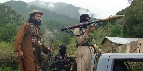 Pakistani Taliban patrol in their stronghold of Shawal in Pakistani tribal region of South Waziristan, Aug. 5, 2012. (AP Photo/Ishtiaq Mahsud)
